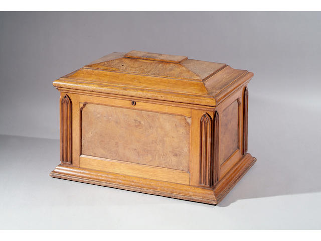 A William IV oak sarcophagus shaped wine cooler, with pollard oak veneered panels and applied Gothic moulding, on plinth base, 76cm wide.