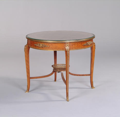 An early 20th century kingwood, tulipwood, parquetry and ormolu mounted centre table by Francois Linke