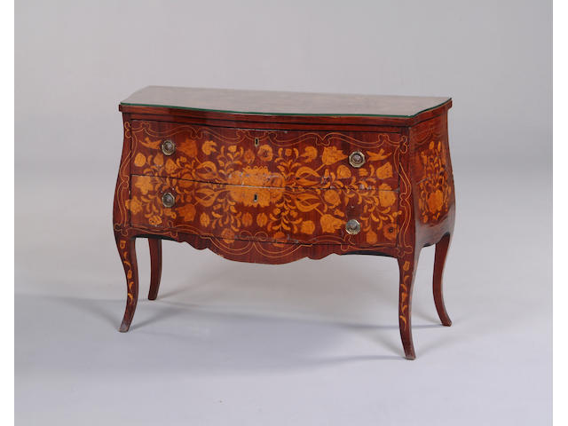A 19th century Dutch rosewood and floral marquetry serpentine commode