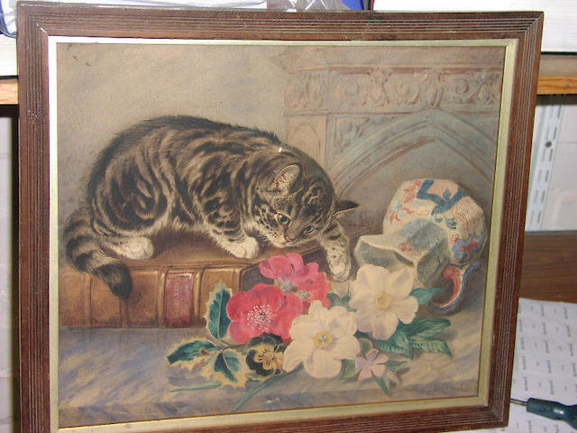 J M Burbank (19th Century), Tabby kitten sitting on a Natural History book, playing with a vase of flowers, 34 x 40cm.