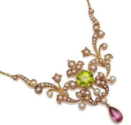 An Edwardian gold peridot and pearl set necklace Centred with an hexagonal collet set peridot within