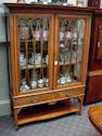An Edwardian inlaid mahogany Sheraton Revival display cabinet,