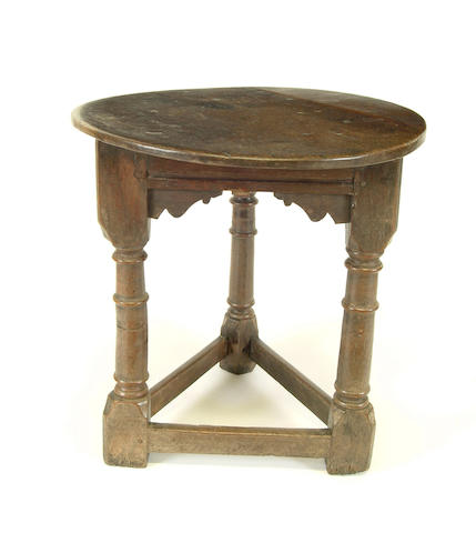 An 18th Century oak cricket table
