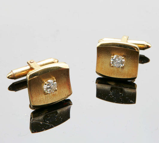 A pair of 14ct gold and diamond cufflinks