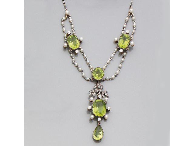A peridot, diamond and seed pearl necklace/pendant,