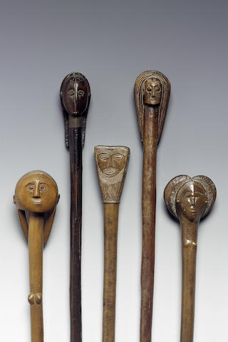 A Collection of five ovimbundu carved wooden staffs 62cm. 5