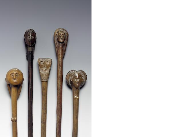 A Collection of five ovimbundu carved wooden staffs 62cm. 5
