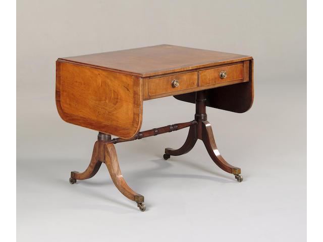 A Regency mahogany, harewood and crossbanded sofa table