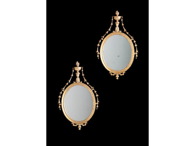 A pair of 19th century gilt carved and composition mirrors