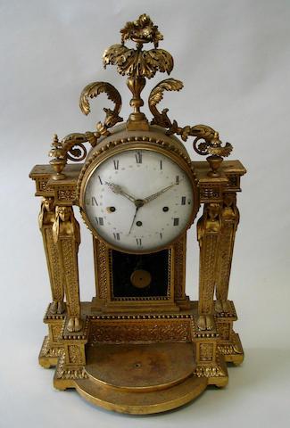 An Austrian Empire period giltwood mantel clock