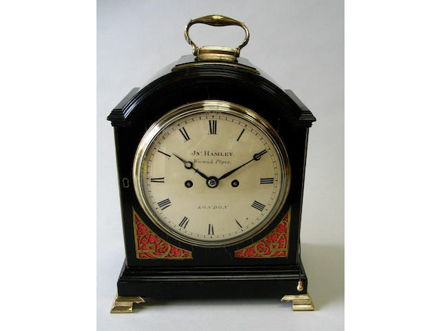 A George III ebonised and brass mounted bracket clock