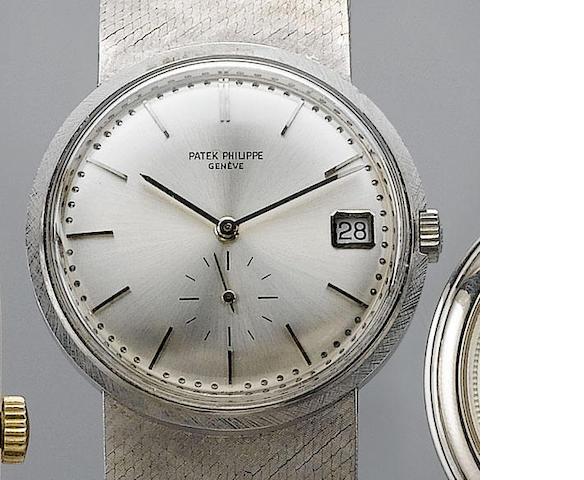 Patek Philippe. An 18ct white gold automatic calendar bracelet watch  Ref:3445, Case No. 328099 Move