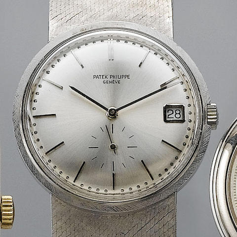 Patek Philippe. An 18ct white gold automatic calendar bracelet watch  Ref:3445, Case No. 328099 Move