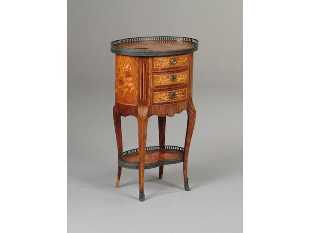 A Louis XVI style kingwood table en chiffonier