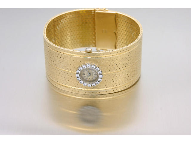 Rolex. An 18ct gold diamond set bracelet watch1960s