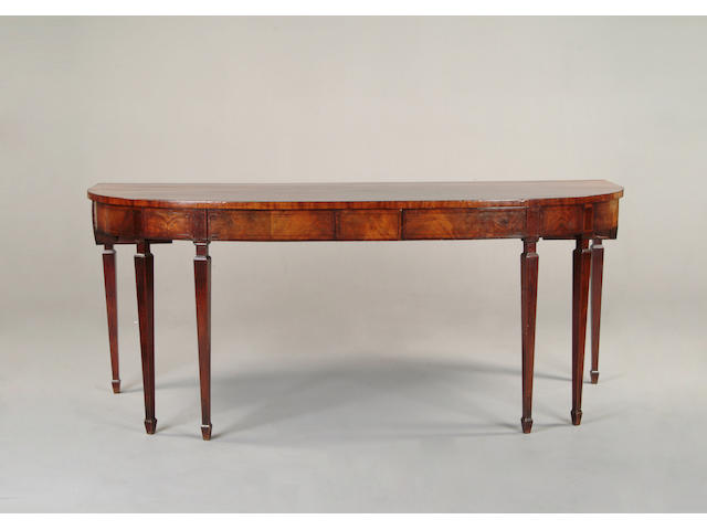 A large George III mahogany and later serving table