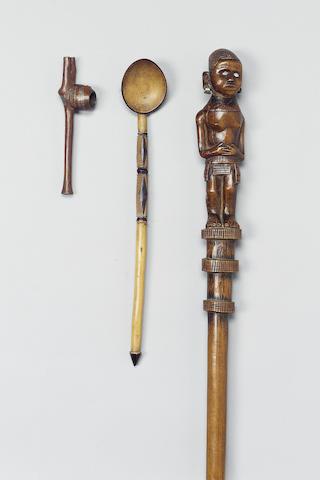 A Zulu pipe, three spoons, Makonde bust, Kamba staff, Zulu shield and assegai (8) 8