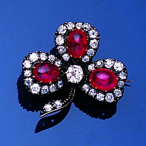 A late Victorian ruby and diamond trefoil brooch,