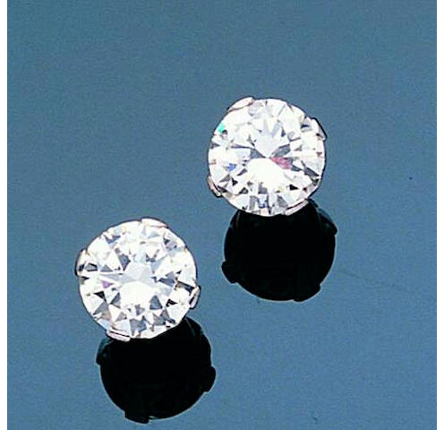 A pair of diamond single-stone earrings