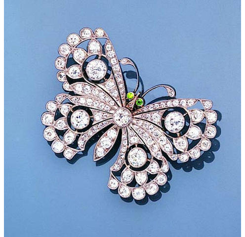 A fine Edwardian diamond and demantoid garnet butterfly brooch,