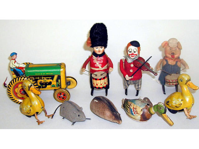 Schuco three c/w figures and other tin toys