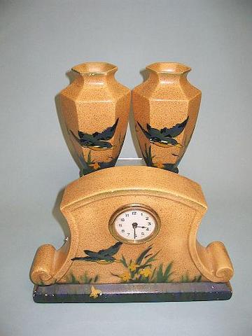 A pottery garniture set circa 1940,