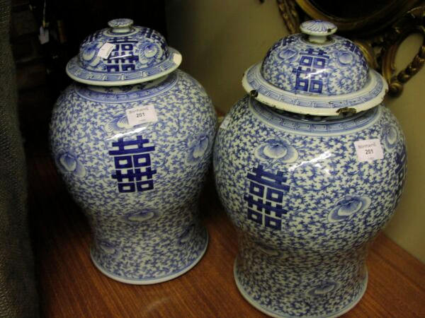A matched pair of Chinese blue and white baluster vases and covers With all over flower and tendril decoration, 43cm high. (4)