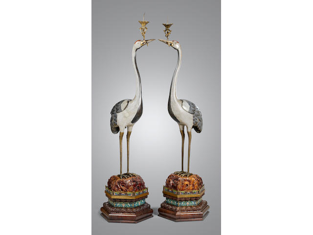 A rare and massive pair of cloisonné enamel standing 'crane' candle holders Jiaqing/Daoguang