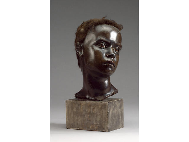 An unusual 19th century French wax bust fragment of the head of a black man