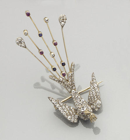 A diamond, ruby and sapphire set bird brooch,