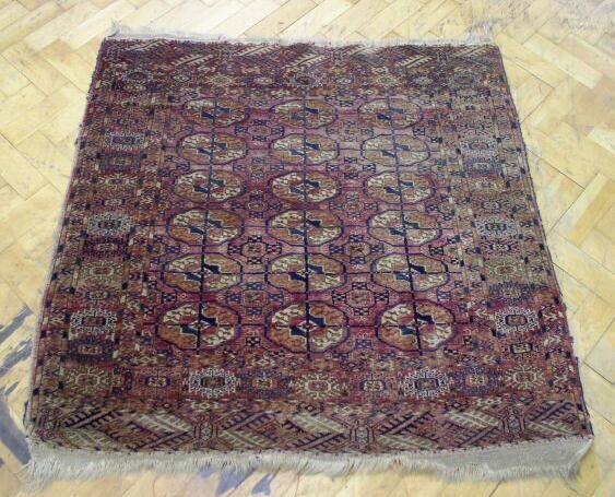 A small Tekke rug of unusual size, 1.10 x 1.10cm