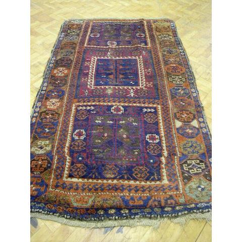An Anatolian rug, 1.30 x 2.24cm