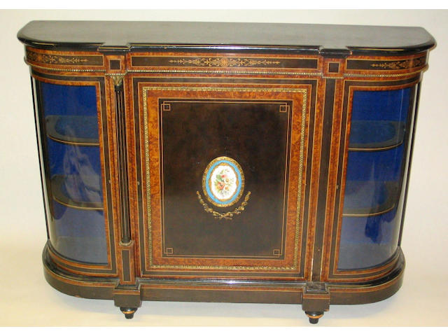 A late 19th Century French ebonised, amboyna crossbanded and inlaid bow end credenza,