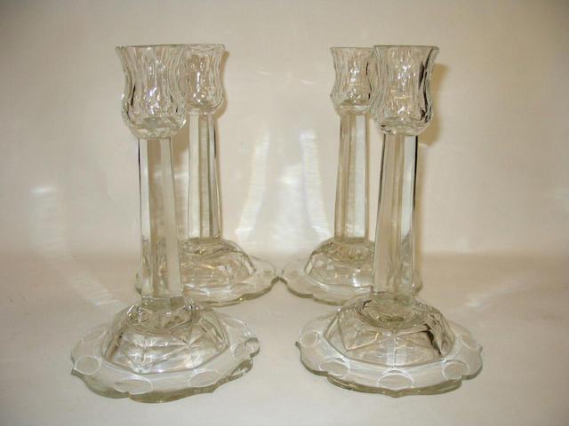 A set of four Georgian style glass candlesticks