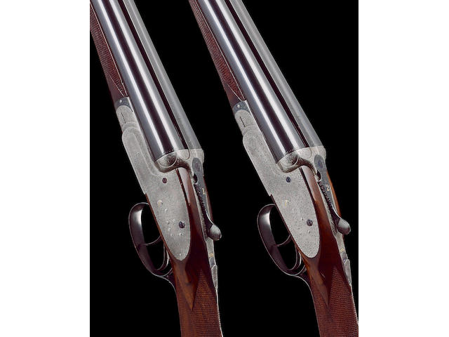 A fine pair of 12-bore (2¾in) 'Grade L60' sidelock ejector guns by W.W. Greener, no. 56992/3 In their brass-mounted oak and leather case