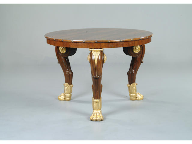 A rosewood and gilt centre table