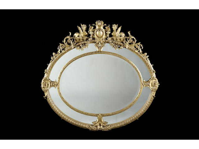 A late 19th century gilt composition oval mirror