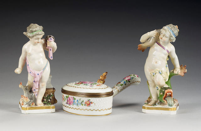 A pair of Continental porcelain figures of putti emblematic of 'Fire' and 'Water' and a French porcelain gilt metal mounted box, 19th and 20th century,