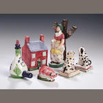 A Scottish pottery figure group of a Girl and Sheep, possibly Portobello,