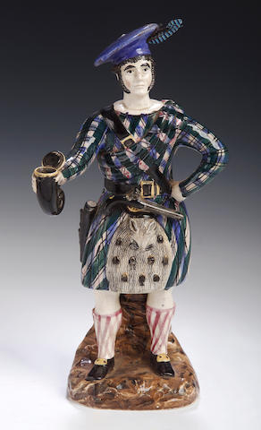 A Scottish pottery figure of a Highlander, probably Rathbone's Pottery, Portobello, circa 1820,