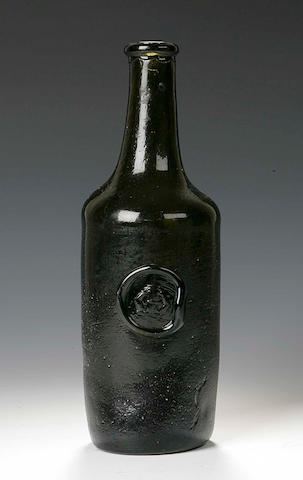 A green glass Wine Bottle, 19th Century,