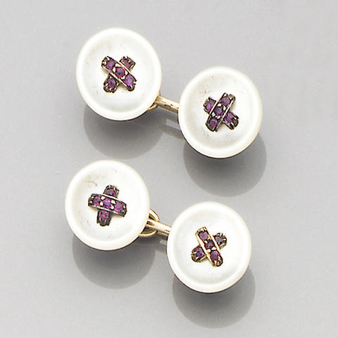 A pair of early 20th century mother-of-pearl and ruby-set cufflinks, French