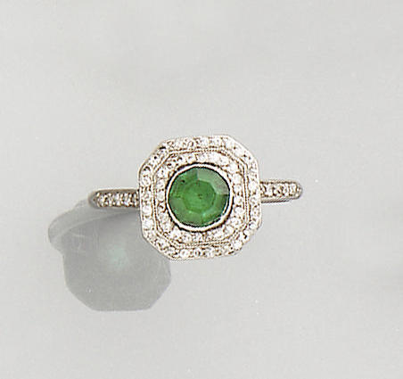 An early 20th century diamond and emerald panel ring, circa 1905