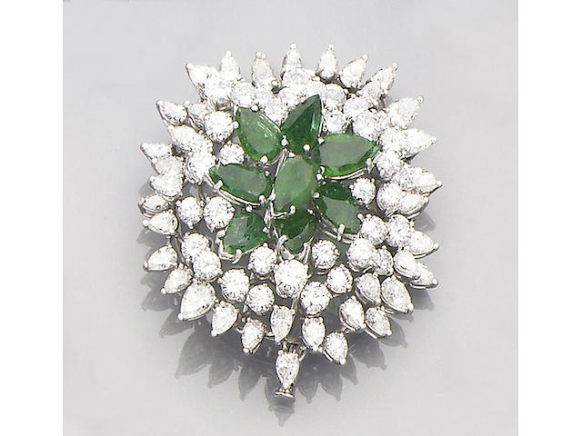 An emerald and diamond ring, brooch and pair of earclips (3)