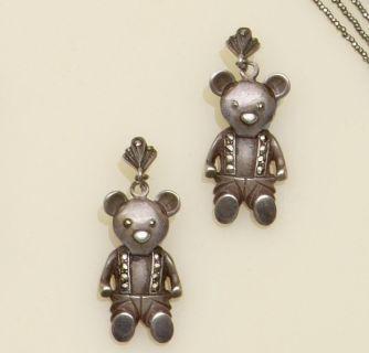 A large colourless paste teddy bear brooch