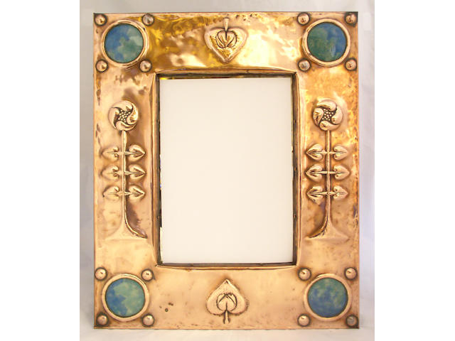 An Arts and Craft copper wall mirror,