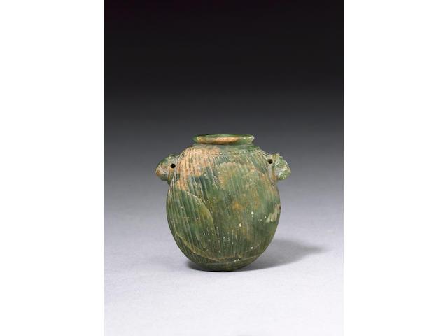A Neo-Assyrian green serpentine kohl vessel