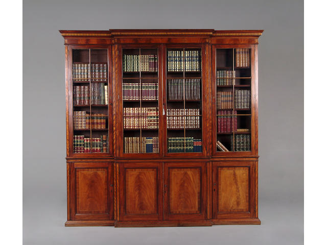 An early 19th century  mahogany and satinwood banded breakfront library bookcase