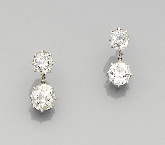 A pair of diamond two-stone earrings