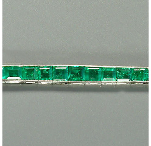 An early 20th century emerald line bracelet,